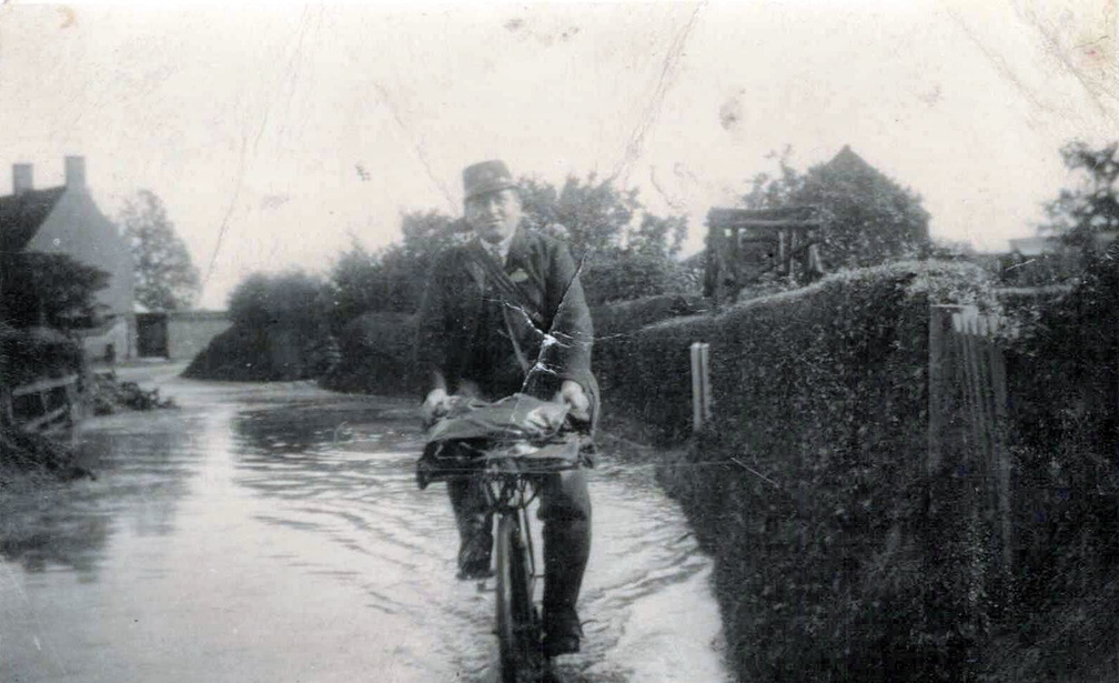 Charlie Curson, postman, in flooded Cross Lane, 1912