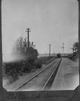 Stanhoe railway station with distant train, probably before the First World War