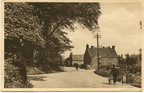 Man with yoke and buckets walking to the well in Docking Road.