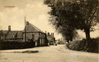 The Street looking west from the corner with Bircham Road and with distant figures. Postcard, c 1920. Loaned JW