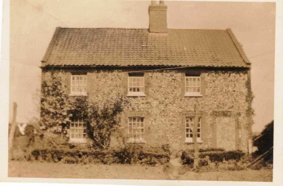 Cottages at Barwick Hall Farm, around 1929.  In the left-hand cottage lived Percy and Sarah Bloy; their daughter Doreen was born here.  In the right-hand cottage lived farm bailiff Henry Bloy and his wife, the parents of Percy Bloy.