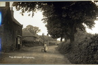 The Street, woman with pram outside the bakery (later Mrs Bloy's shop and now Fern Cottage). Postcard, c1920.