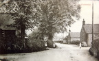 The Street looking east, Cross Lane, Methodist chapel with elm trees, four children. Postcard, c 1930s.