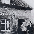John Thomas Mitchley and his wife Elizabeth (née Pygall) outside their cottage next to the Crown. There were then three cottages in the row; this is the one furthest from the Crown. 1920s or 1930s.