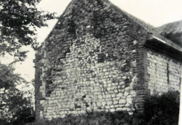 A chalk and brick cottage on the east side of the Pit.