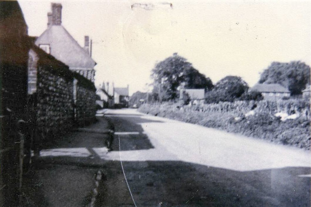 The Street, looking west, with high wall, 1950s
