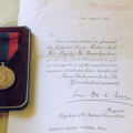 Imperial Service Medal and letter of commendation received in 1957 by Charlie Seaman, former Air Raid Precautions (ARP) warden in Stanhoe, for his part in the rescue of crew members of a Wellington bomber which crashed near Stanhoe Hall in 1943.