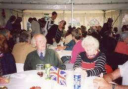 Queen's Golden Jubilee 2002: party in a marquee on the playing field, Ken and Joan Foskett in foreground