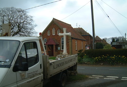 Erecting the new cross at the top of Cross Lane, 26 April 2001