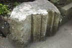 Cut stones, possibly from St Peter's chapel, in Roddy Rowe's garden, Cross Lane, 2013