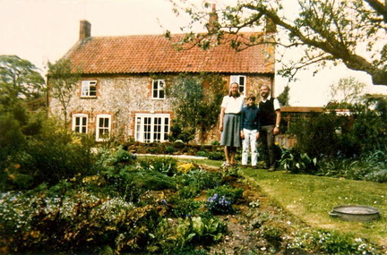 Gillian and Ken Beckett and their son in the garden of Bramley Cottage