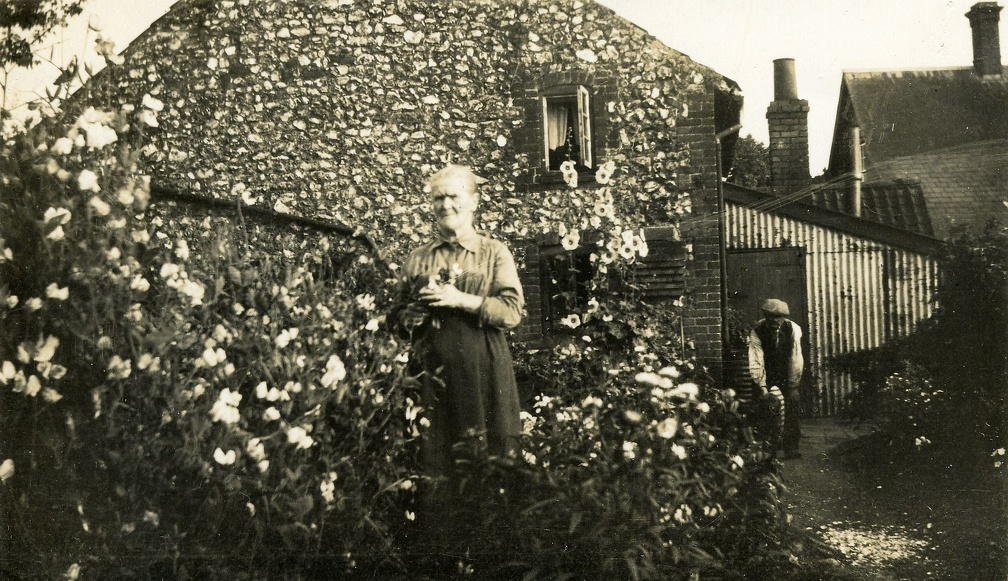 Polly Ayres ouside the end cottage in Post Office Yard. Mary Jane Ayres, known as Polly, and her husband Robert were the parents of Stanley, XX and Reggie, and grandfather of Doreen