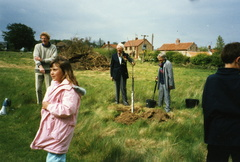 Planting the Jubilee oak tree on the playing field Dennis Ford, Claire Barber, Roy Cooper, Mrs Symington