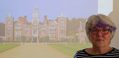 Kate next to her projected image of Blickling Hall