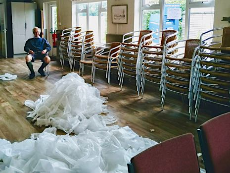 Mark Roche takes a well-earned break next to the new chairs and piles of wrapping material