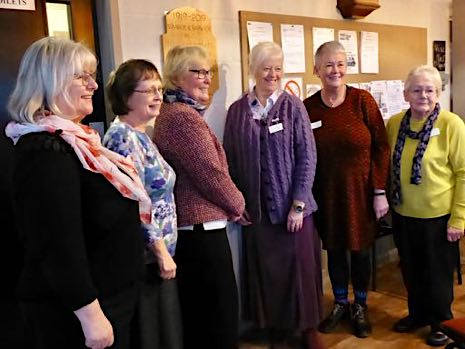 WI members in front of the centenary plaque