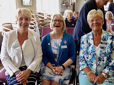 Louise Casson, Margaret Collingwood and Coral Batchelor seated in Stanhoe village hall