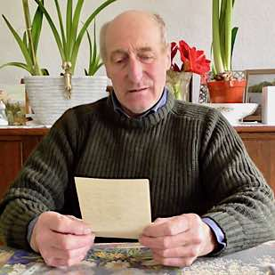 Gerald Oldfield reads the WI letter written by his father Cecil