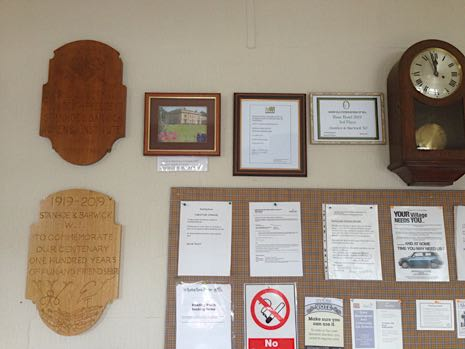 WI certificates and other framed items on the Reading Room wall