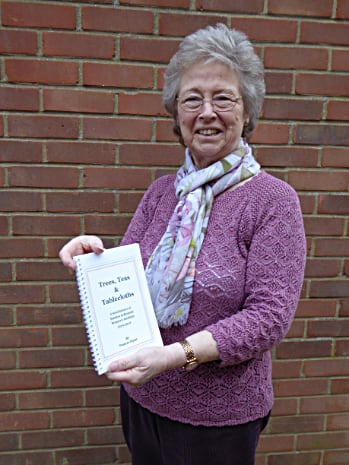 Frances holding a copy of her Stanhoe WI history book