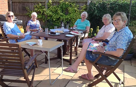 WI members at a table in a garden on a sunny September day