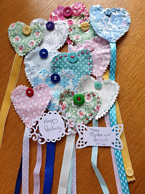 Hand-stitched heart-shaped bookmarks made by Nicki Smith